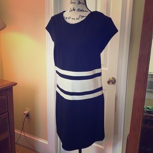 Capped sleeved black and white dress.